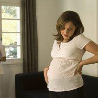 Болит поясница на 14 неделе беременности